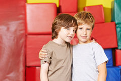 Two boys are friends in preschool. Two boys are friends in gym of a preschool Stock Images