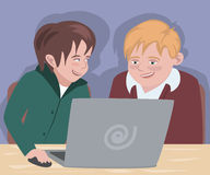 Two boys in front of computer Stock Images