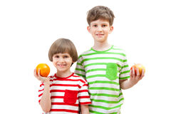 Two boys with fruits Royalty Free Stock Photos