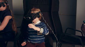 Two boys and a girl playing virtual reality game stock video footage