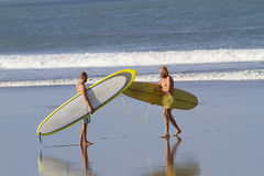 Two boys go surfing Royalty Free Stock Image