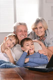 Two boys and grandparents with a laptop Royalty Free Stock Photography