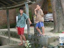 Two boys guard fountain - Live in Kathmandu - Nepal Stock Photography