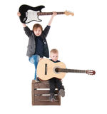 Two boys with guitars on a box Royalty Free Stock Image