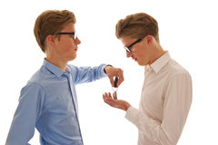 Two boys handing over keys Stock Image