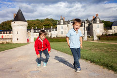 Two boys, happily playing after the rain on the driveway of Fren Stock Images