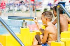 Two boys having fun in aqua park. Two happy boys having fun in aqua park Royalty Free Stock Image