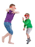 Two boys having fun wearing 3D glasses Stock Photo