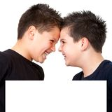 Two boys with heads together behind copyspace Royalty Free Stock Photography