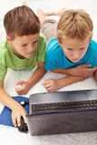 Two boys in the heat of a computer game Royalty Free Stock Photography