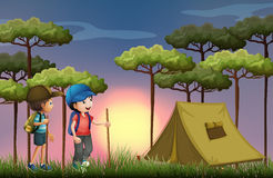 Two boys hiking and camping in the forest Royalty Free Stock Image