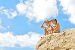 Two boys on a hill Royalty Free Stock Photos