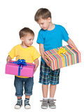 Two boys hold gift boxes Stock Photos