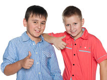 Two boys hold their thumbs up Royalty Free Stock Photography