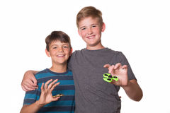 Two boys holding fidget spinners. And smiling at the camera Stock Image