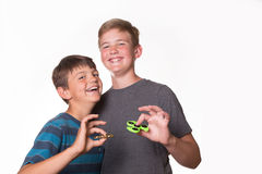 Two boys holding fidget spinners. And smiling at the camera Royalty Free Stock Images