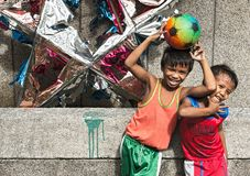 Two boys holding a football and posing in Ermita, Manila stock photo