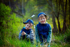 Two boys holding stick and  ready for eating roasted marshmallow Royalty Free Stock Photo