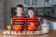 Two boys at home, preparing pumpkins for halloween Stock Photo