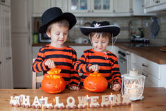 Two boys at home, preparing pumpkins for halloween Stock Images