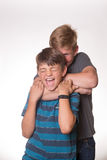 Two boys hugging/choking each other. While laughing Royalty Free Stock Photography