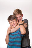 Two boys hugging/choking each other. While laughing royalty free stock photo