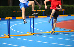 Two boys jumping over hurdles Royalty Free Stock Photography