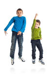 Two boys jumping on white background. Royalty Free Stock Image
