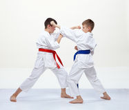 Two boys in karategi are training blocks and bumps Royalty Free Stock Photos