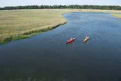 Two boys kayaking. Royalty Free Stock Photos