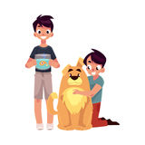 Two boys, kids - hugging fluffy dog and holding fish aquarium Stock Photos