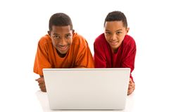 Two boys with laptop Stock Images