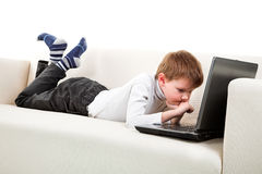 Two boys with laptop. On the sofa Stock Image