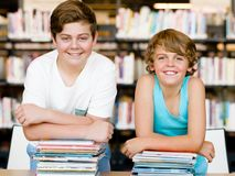 Two boys in library Royalty Free Stock Images