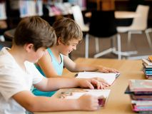 Two boys in library Royalty Free Stock Photography