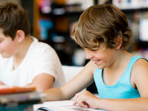 Two boys in library Stock Image