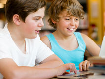 Two boys in library. With notebook Stock Images
