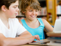 Two boys in library Stock Photos