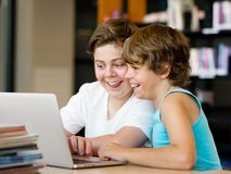 Two boys in library. With notebook Stock Photo