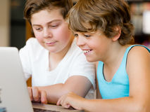 Two boys in library. With notebook Stock Photography