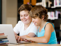 Two boys in library Royalty Free Stock Image