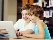 Two boys in library. With notebook Stock Image