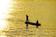 Two boys in a lonely boat Stock Images