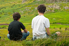 Two boys looking at a beautiful landscape Stock Photo