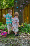 Two Boys Looking for Easter Eggs Royalty Free Stock Photos