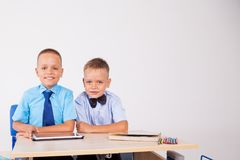 The two boys are looking at Internet Tablet school. 1 Royalty Free Stock Photography