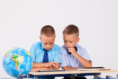 The two boys are looking at Internet Tablet school. 1 Stock Photography