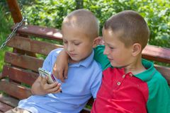 Two boys a looking smartphone,two friends are browsing the smartphone video Stock Photo