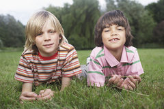 Two Boys Lying In Meadow Stock Photo
