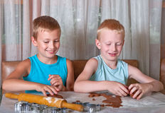 Two boys making cookies Stock Images